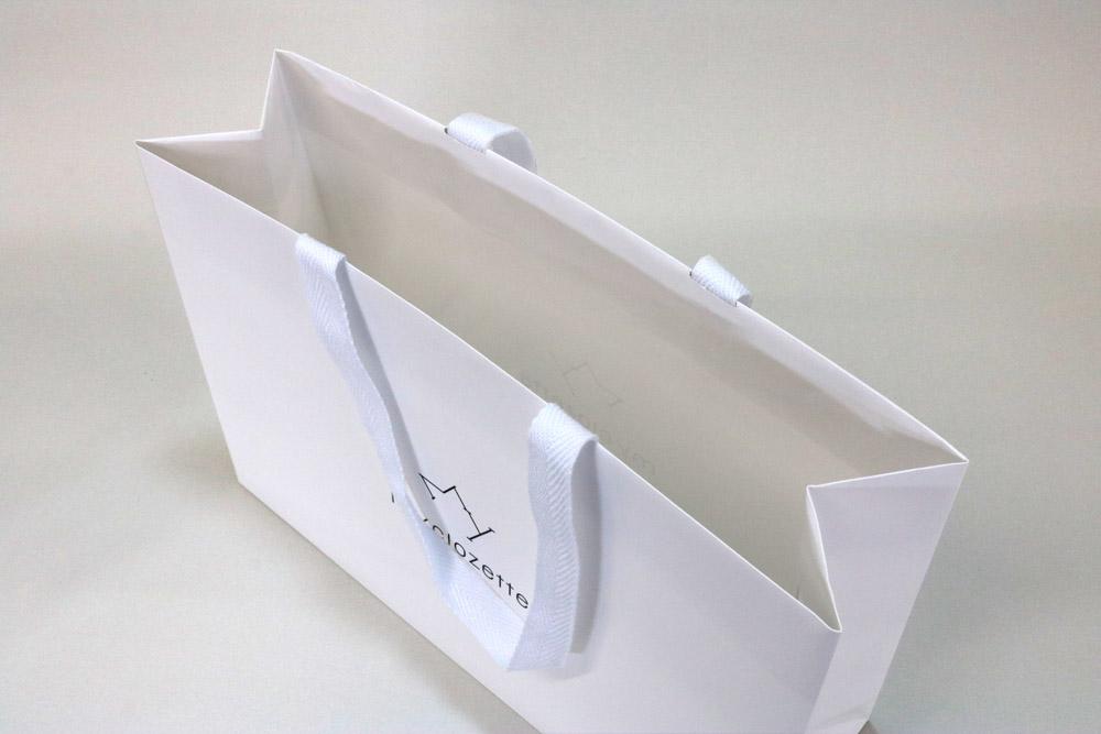 コート紙 表面マットPP貼りターントップ仕様、オフセット1色印刷(ベタ無し)の別注紙袋の入れ口画像