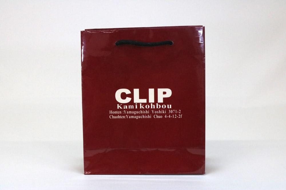 コート紙 表面グロスPP貼り、オフセットベタ1色印刷の別注紙袋の正面画像