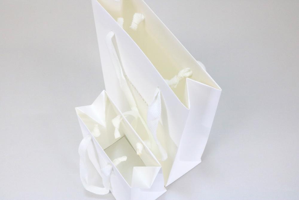 タント 表面加工なし、箔押艶金1色の別注紙袋の入れ口画像