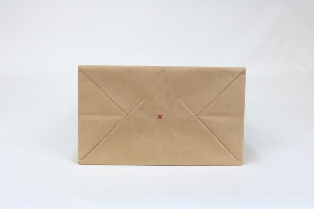 未晒クラフト(茶)表面加工なし入れ口ギザギザタイプ、フレキソ1色印刷の別注輪転紙袋の底面画像