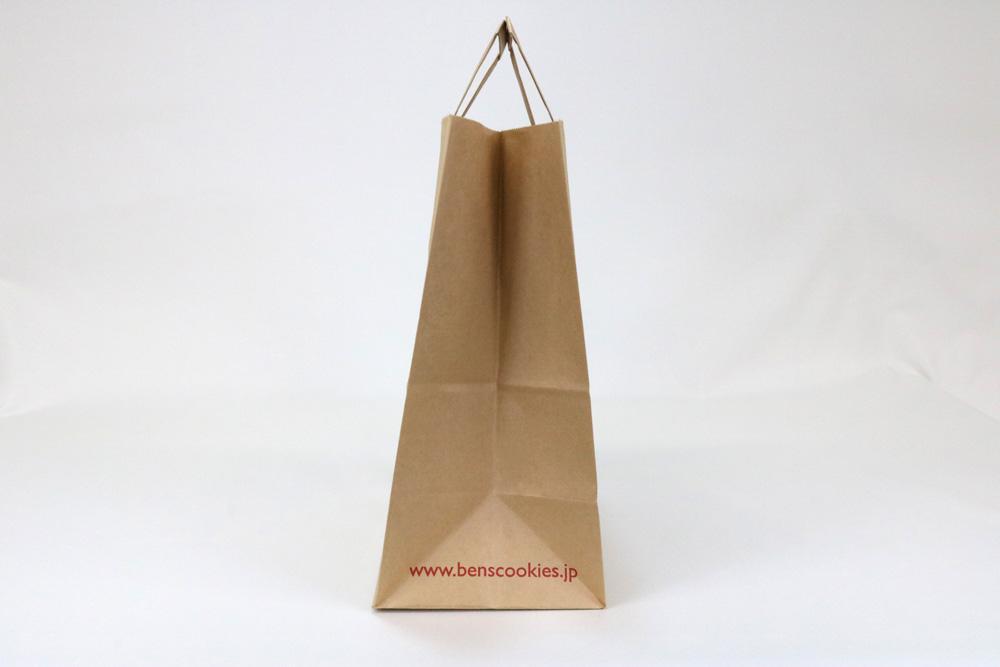 未晒クラフト(茶)表面加工なし入れ口ギザギザタイプ、フレキソ1色印刷の別注輪転紙袋の側面画像