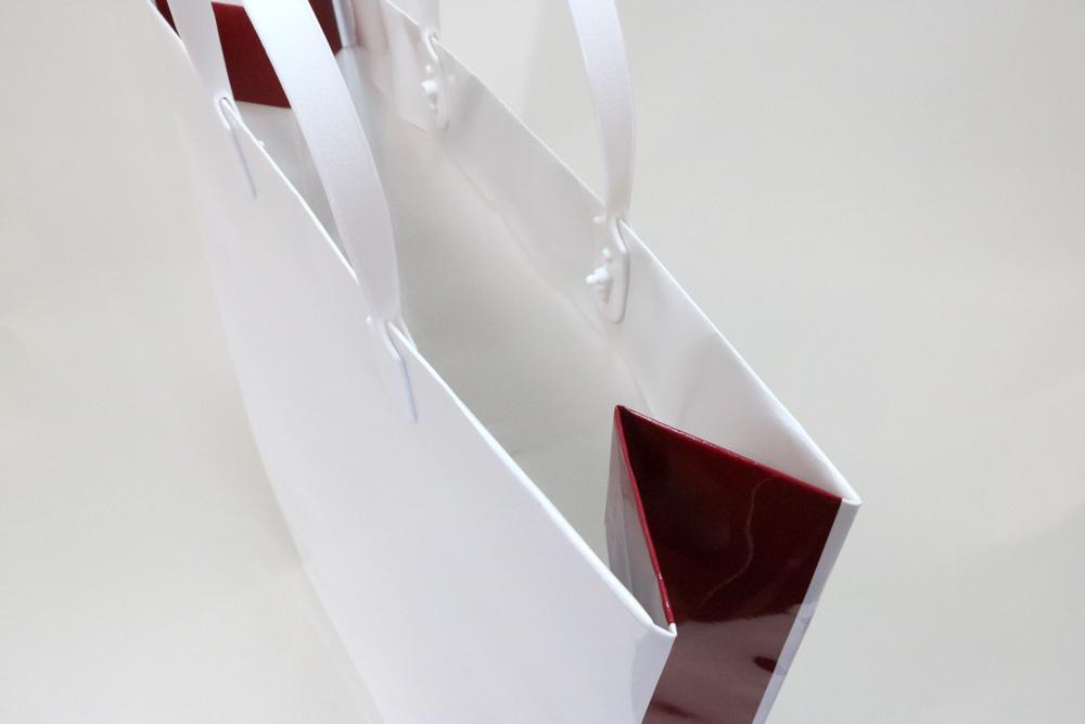 コート紙表面グロスPP貼り、オフセット印刷2色の別注紙袋の入れ口画像