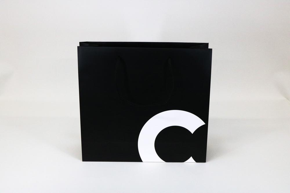 コート紙表面マットPP貼り、オフセット印刷ベタ1色の別注紙袋の正面画像