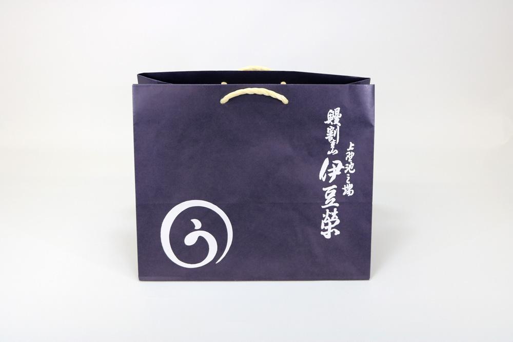 晒クラフト120g/㎡表面加工無し、オフセット印刷ベタ1色+ニス引きの別注紙袋の正面画像
