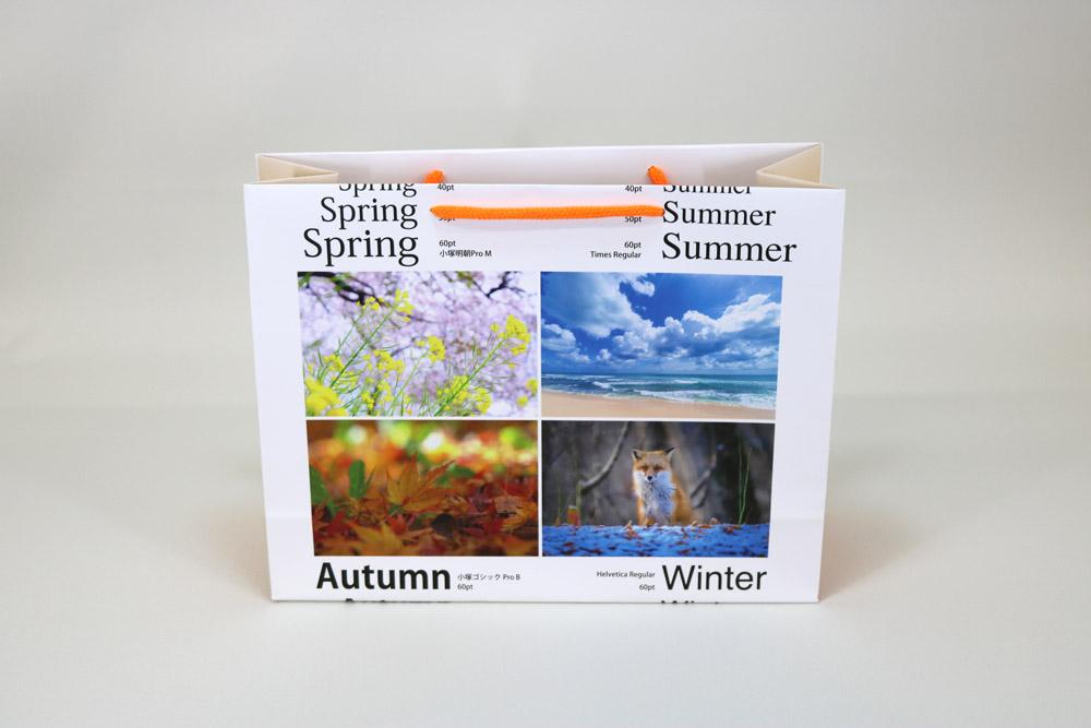 コート紙表面マットPP貼り、オンデマンド印刷カラー4色の別注紙袋の正面画像