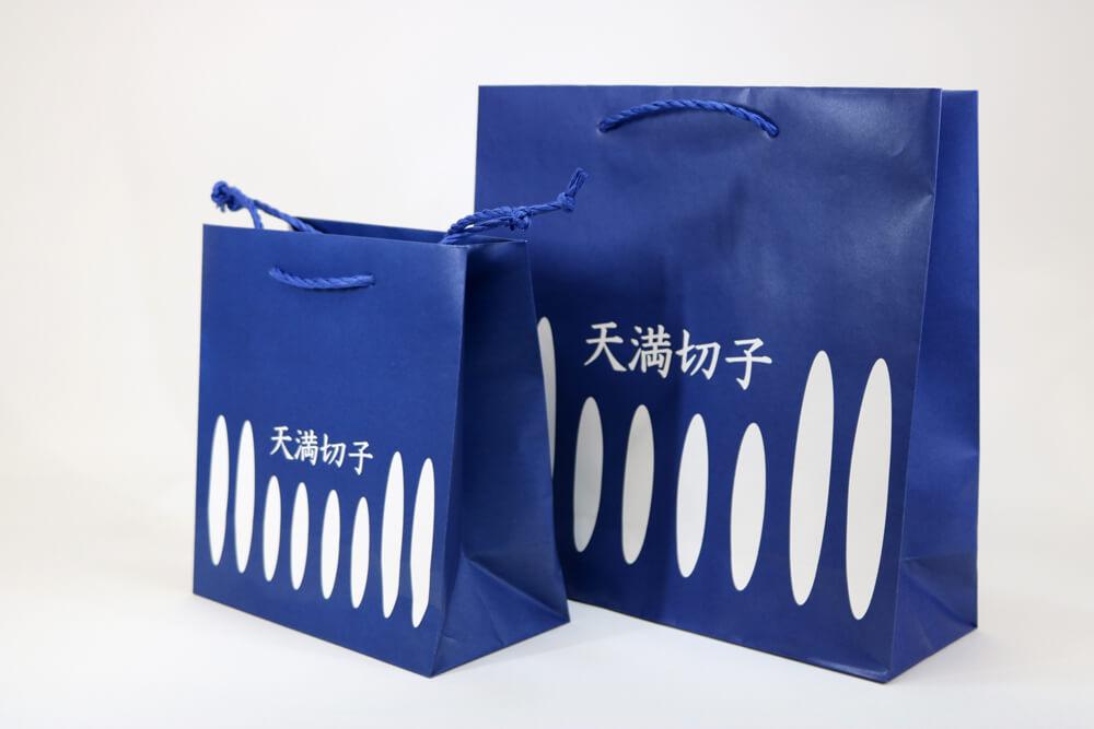 片艶クラフト120g/㎡表面ニス加工、オフセット印刷ベタ1色の別注紙袋