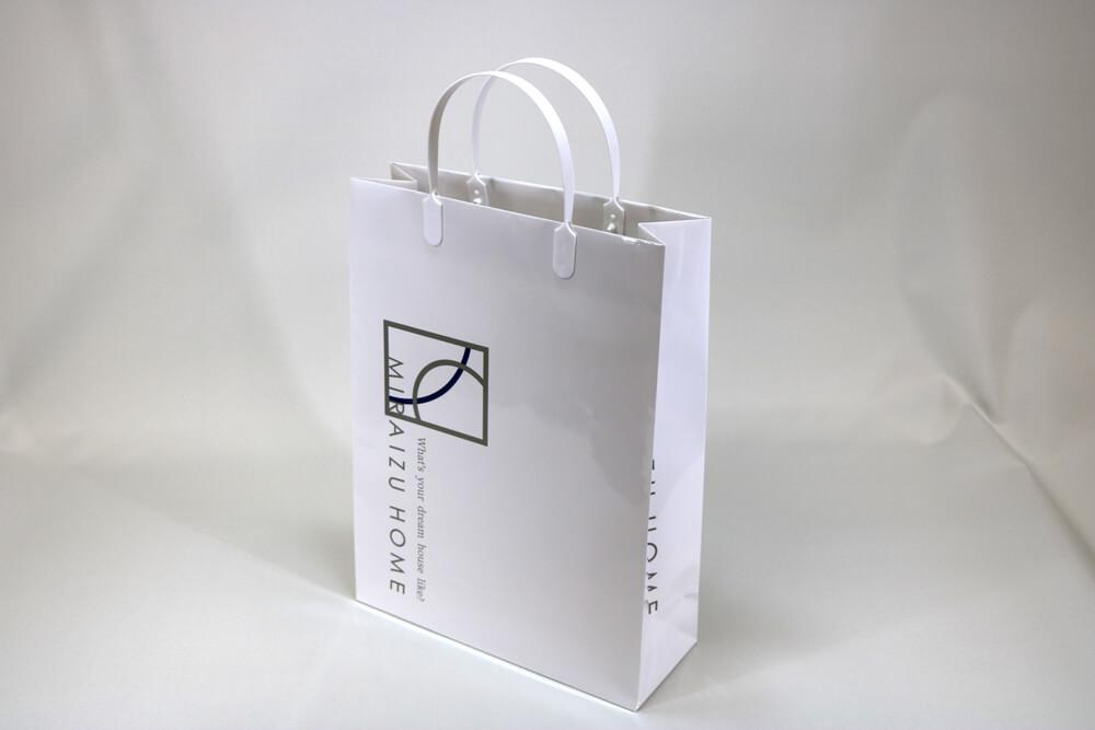 コート紙表面グロスPP貼り、オフセット印刷2色の別注紙袋