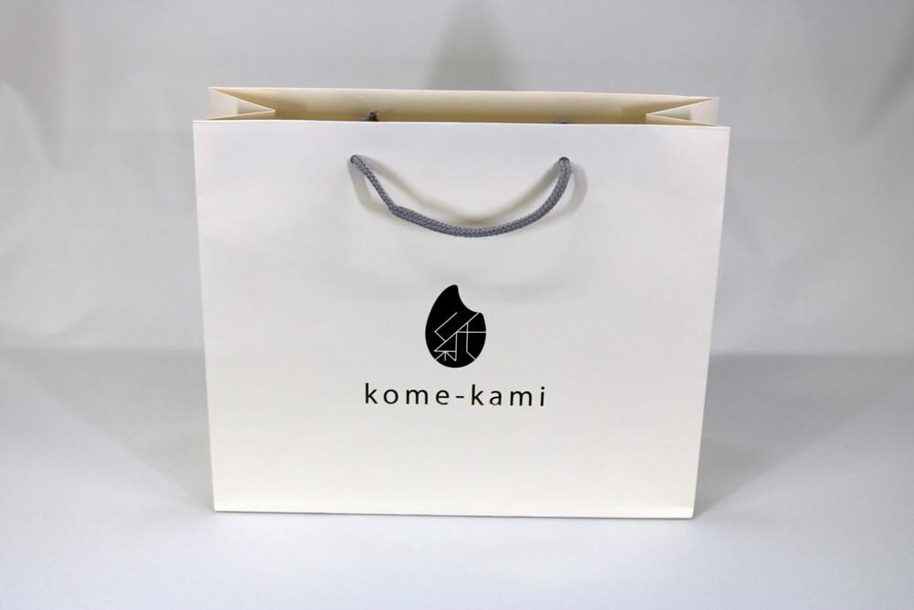 kome-kami素材、片面1カ所箔押しのセミオーダー紙袋の正面画像
