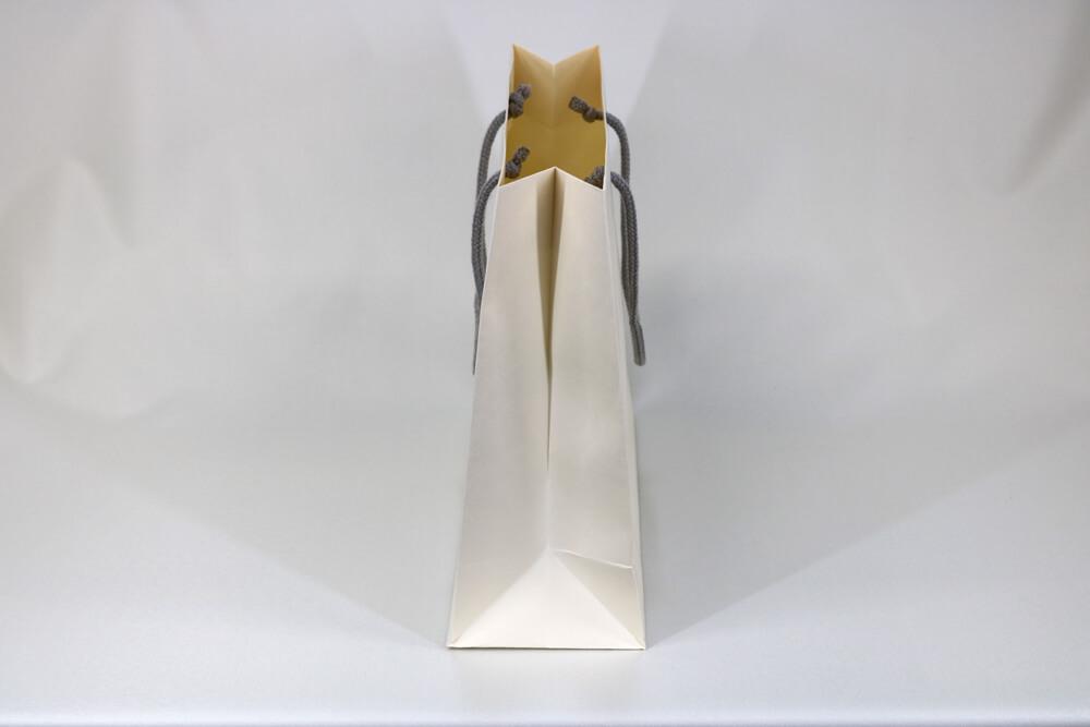 kome-kami素材、片面1カ所箔押しのセミオーダー紙袋の側面画像